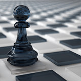 glass pawn of dark color on a chess cells