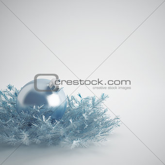 Christmas ball of gentle blue color in an environment of a tinsels and decorations