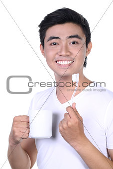Asian guy brushing teeth