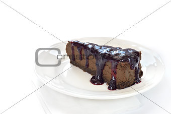 Slice of chocolate cheesecake on white plate