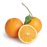 ripe round oranges with half, stem and leaf