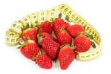 Measuring tape around a strawberry as a symbol of diet