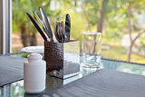 Incomplete Dining table setting at a picture wi