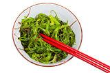 eating of chuka salad - seaweed salad