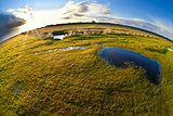 pond, pasture and sun via fisheye view