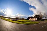 sun over Dutch farm house, fisheye view