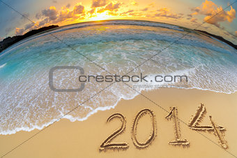 new year 2014 digits on ocean beach sand