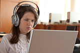Girl is using computer with headphones