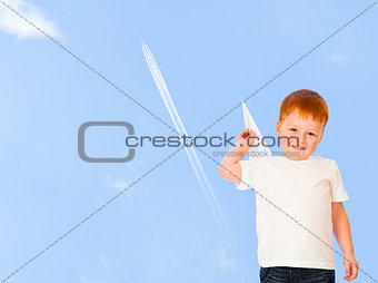Adorable red-haired boy with paper plane model on blue sky