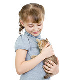 Girl holding British kitten isolated on white