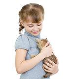 Girl holding British kitten isolated on white