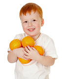 redheaded boy with oranges isolated on white