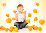 redheaded boy with falling oranges