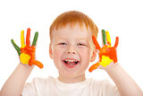 Adorable red-haired boy with hands painted in bright colors isol