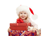 happy child in Christmas Santa's hats with gift boxes