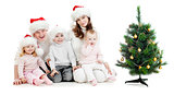 happy family in Snta's hats near christmas tree isolated on whit
