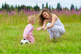 Mother and daughter in meadow outdoor