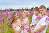 Happy family together in meadow