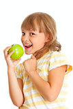 Schoolgirl portrait eating green apple isolated