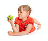 School girl portrait eating green apple isolated