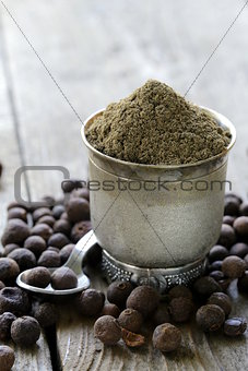 ground black pepper on a wooden table
