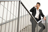 Young businessman in an office building talking on the phone