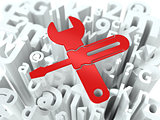 Wrench and Screwdriver on Alphabet Background.