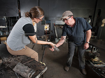 Two People Shaping Glass