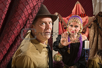 Scared Man with Fortune Teller