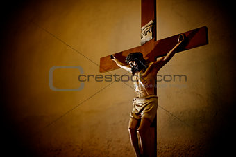 Catholic church and Jesus Christ on crucifix