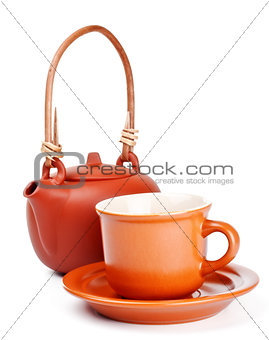 clay kettle and cup with saucer