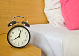 alarm-clock in morning bedroom