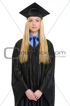 Portrait of young woman in graduation gown