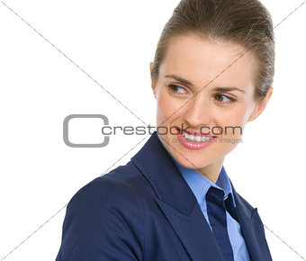 Portrait of happy business woman looking on copy space