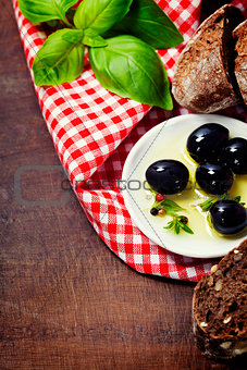 Olives and Olive Oil on an old tablel