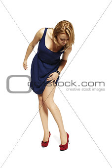 Attractive young woman watching her leg