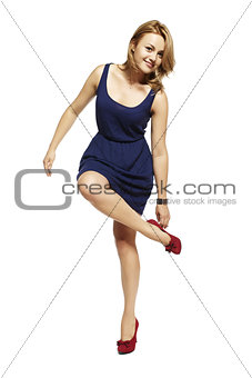 Attractive woman standing on one leg