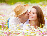 Two lovers on floral meadow