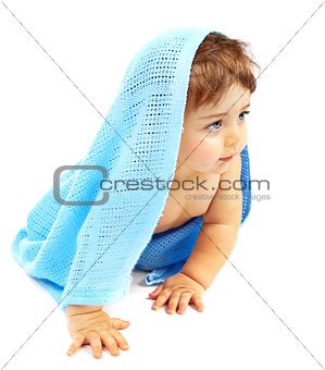 Sweet little baby boy covered blue towel
