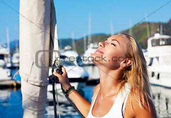 Woman tanning on luxury yacht