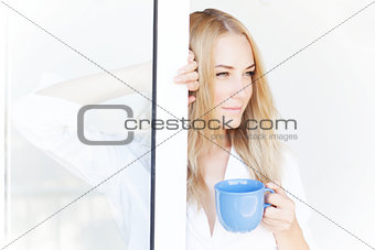 Young lady with tea mug