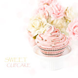 Pink cupcake.