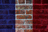 French Flag on Brick Wall Background