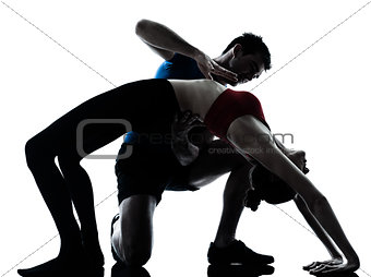 coach man woman exercising yoga bridge position gymnastic