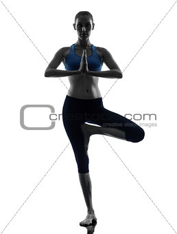 woman exercising tree pose yoga