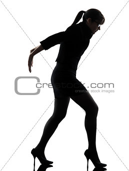 business woman pushing silhouette