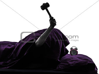 one person bed smashing alarm clock silhouette