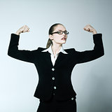one strong powerful woman flexing muscles proud