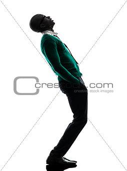 african black man standing looking up  surprised silhouette