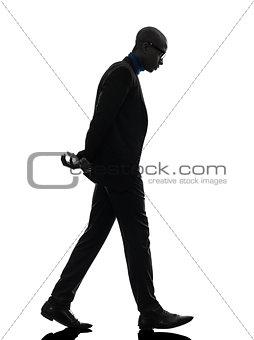 african black man walking looking down  silhouette
